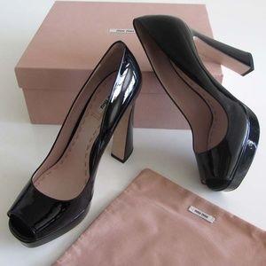 MIU MIU platform peep-toe pumps flared heels 40 10